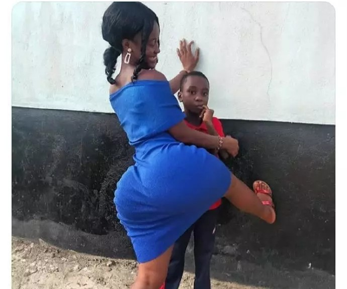 People Call For The Arrest Of A Lady Playing With Her Little Cousin While Posing Indecently